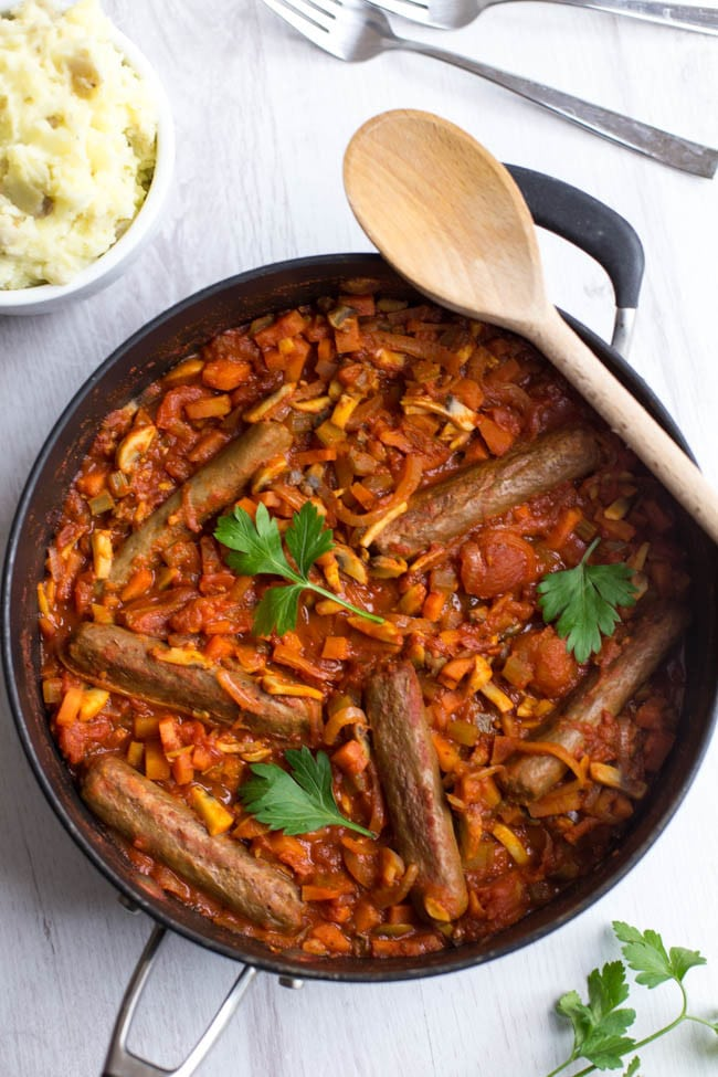 Vegetarian sausage casserole - a rich, tomatoey stew with vegan sausages and heaps of veggies. Comfort food made healthy!