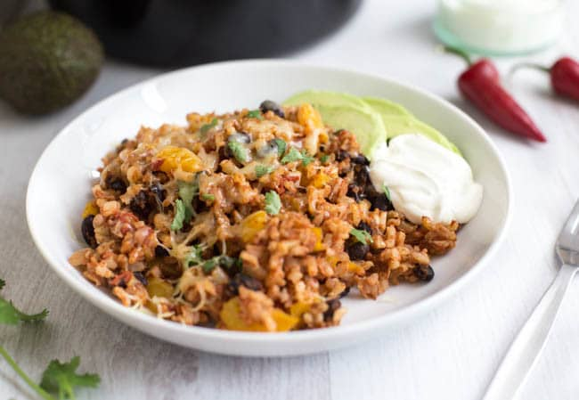 Vegetarian slow cooker burrito bowls with sour cream and avocado