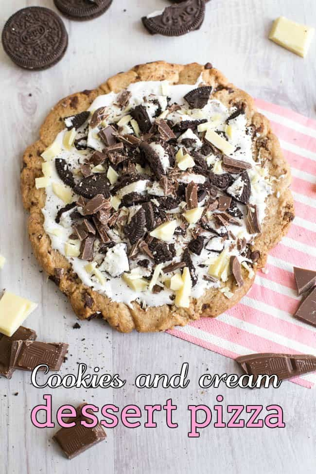 Cookies and cream dessert pizza - this would be such a great alternative to a birthday cake! A huge chocolate cookie, covered with marshmallow fluff and topped with Oreos and chocolate. It's easy to make but a real showstopper!