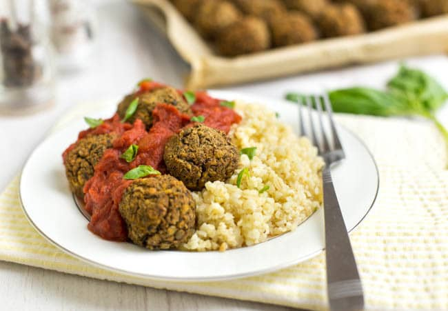 Mediterranean lentil meatballs with a rich tomato sauce - completely vegan! The best vegetarian meatballs I've ever made, flavoured with olives and fresh basil, and perfect served with spaghetti or your favourite grain.