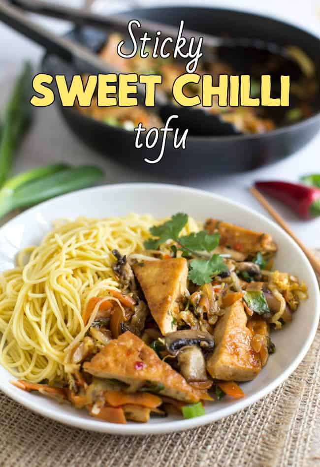 Sticky sweet chilli tofu - a quick, easy and delicious vegetarian / vegan dinner! Cook the tofu until crispy, then add the sauce and let it get nice and sticky!