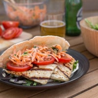 Balsamic halloumi pittas with carrot slaw