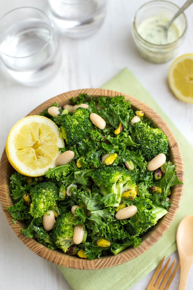 Superfood kale salad - a super healthy salad with tons of tasty superfoods - broccoli, pistachio nuts, cannellini beans, and a creamy herb dressing. So perfect!