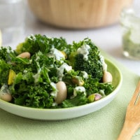 Superfood kale salad with creamy herb dressing