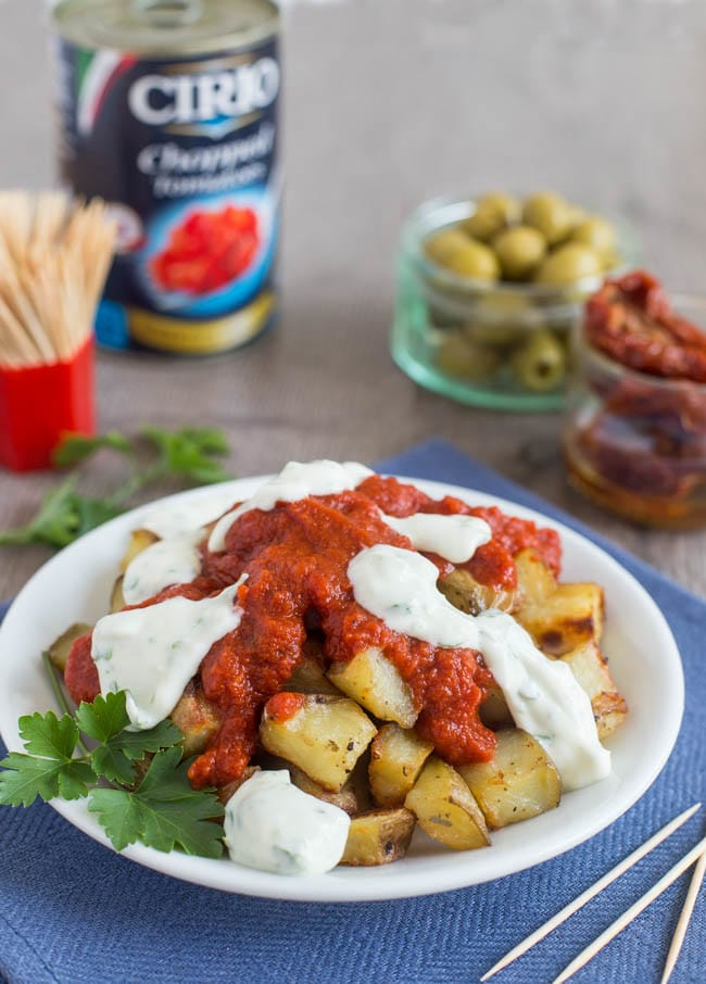 Easy patatas bravas with garlic aioli - a simple version of the Spanish tapas. Crispy potatoes with a spicy tomato sauce and creamy garlic mayonnaise!
