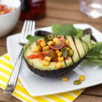 Grilled avocado with spicy tomato salsa