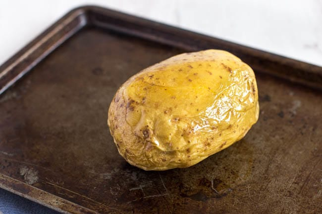 How to make the PERFECT baked potato! This method gives a soft and fluffy centre, with a crispy skin - and even includes a time-saving tip. My favourite method for making jacket potatoes!
