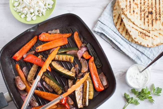 Easy vegetarian fajitas, made Mediterranean with balsamic vinegar, feta cheese and a herby yogurt dressing. Quick and delicious!