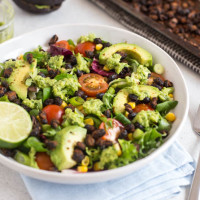 Roasted black bean taco salad with avocado lime dressing