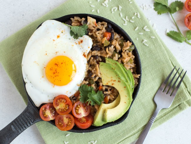 Breakfast rice and beans - my own take on a Costa Rican dish called pinto gallo! This delicious vegetarian recipe contains a complete protein, healthy fats and tons of veggies! The perfect way to start the day.