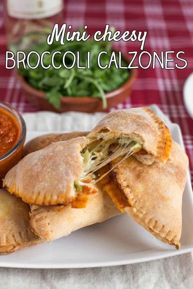 Mini cheesy broccoli calzones - stuffed with tomato sauce, garlicky broccoli and ooey gooey mozzarella! The perfect cheesy handheld nibble.