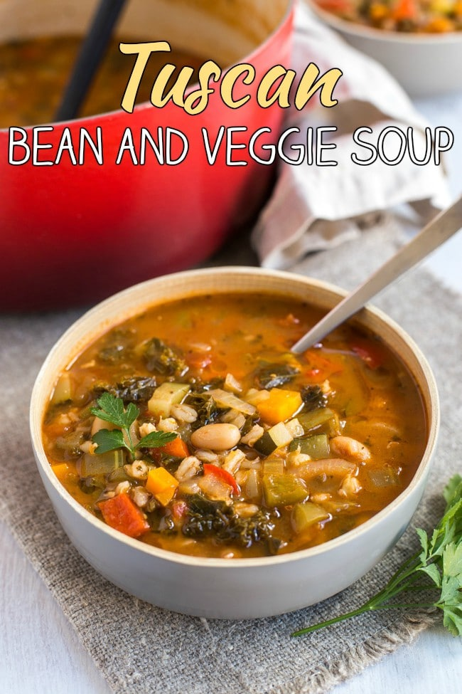 Tuscan bean and veggie soup - a super hearty vegetarian / vegan soup that's full of veggies, barley and beans! Comfort food made healthy!