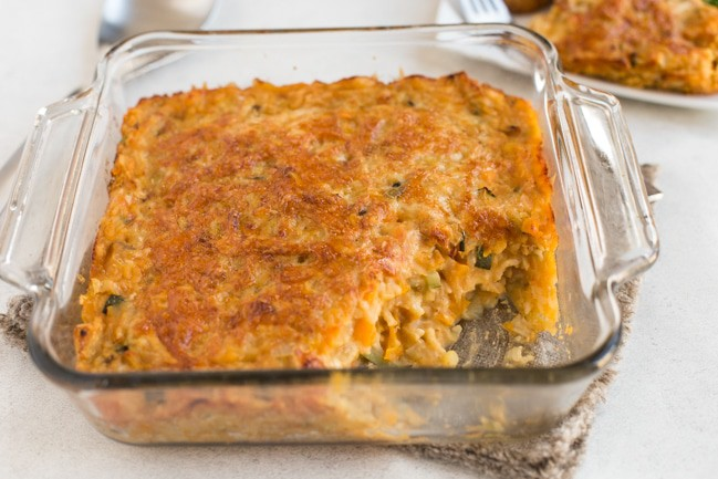Very veggie lentil bake in a baking dish with a portion removed