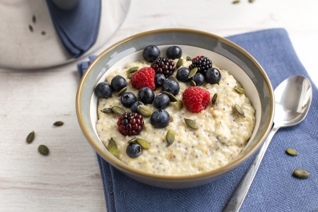Superfood porridge with quinoa, flax and chia, as well as the usual oats. Topped with pumpkin seeds and berries for even more goodness! A super healthy vegetarian / vegan / gluten-free breakfast.