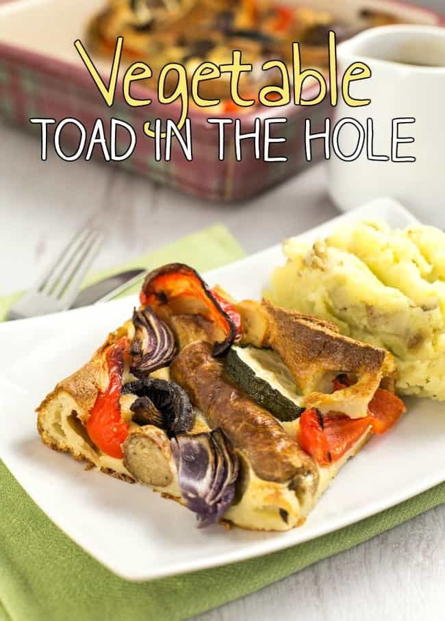 Vegetable toad in the hole - vegetarian sausages and roasted veggies, all cooked in a Yorkshire pudding batter. A classic British recipe!