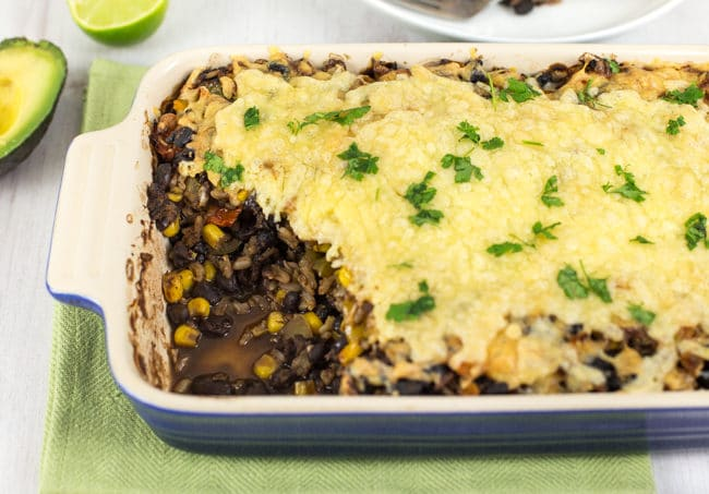 Mexican black bean casserole - easy to make, and full of spicy Mexican flavour! Plenty of protein and veggies - not to mention that crispy cheese topping :) Vegetarian and gluten-free.