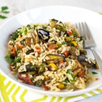 Warm brown rice salad with roasted aubergine and pistachios