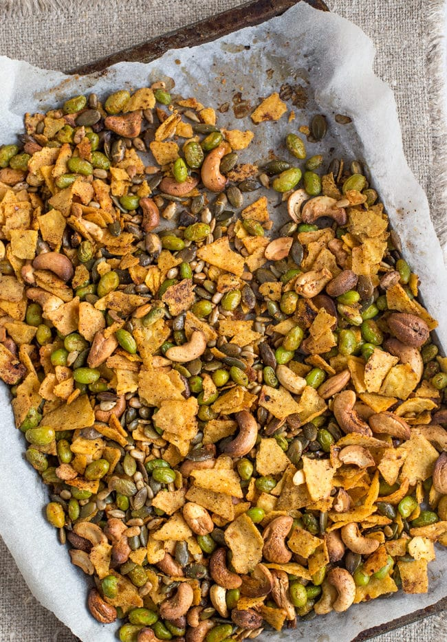 Cajun spiced savoury trail mix - with crispy nuts and seeds, roasted edamame, and crushed tortilla chips! All roasted up in an easy Cajun spice mix. It's high protein, vegan, vegetarian, gluten-free, AND totally delicious!