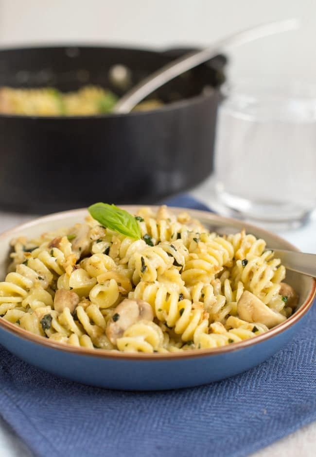 Creamy goat's cheese and mushroom pasta with walnuts and basil. The walnuts add such a beautiful crunch - it's great against the creamy sauce! A brilliant quick and easy vegetarian dinner.