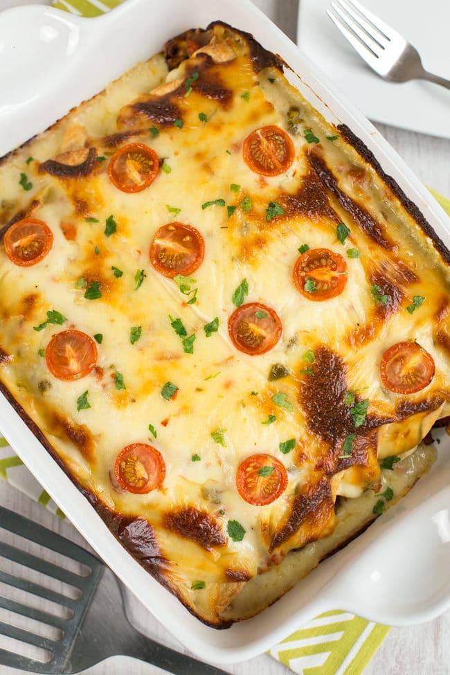 Vegetarian Refried Bean Enchiladas With A Creamy Jalapeno Cheese Sauce The Best Enchiladas Ever
