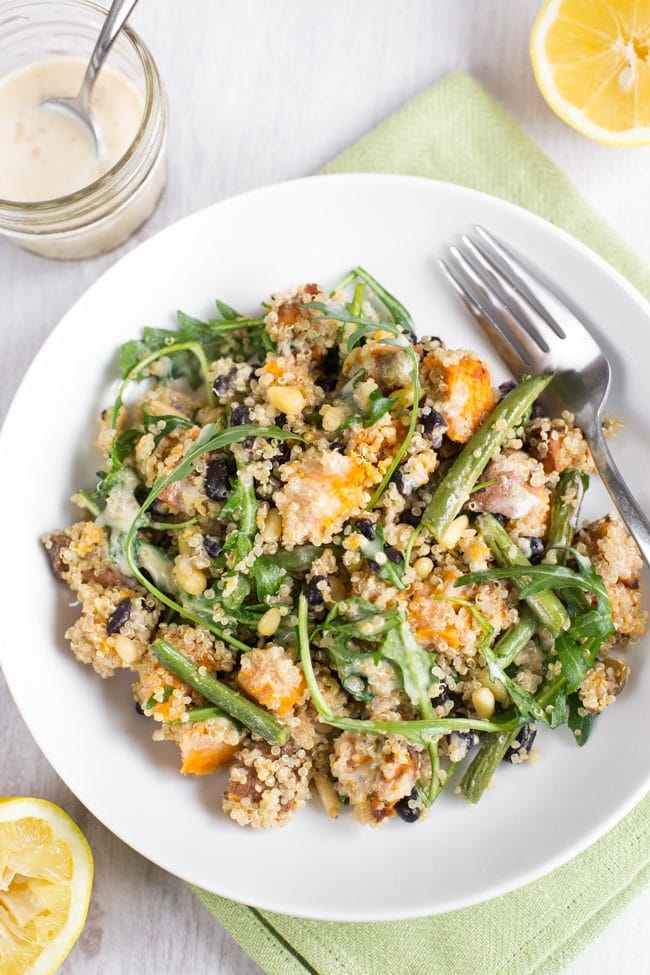 Sweet potato quinoa salad with a creamy tahini dressing - so delicious, so healthy, so easy to adapt depending on what you have in the fridge! Vegan and gluten-free.