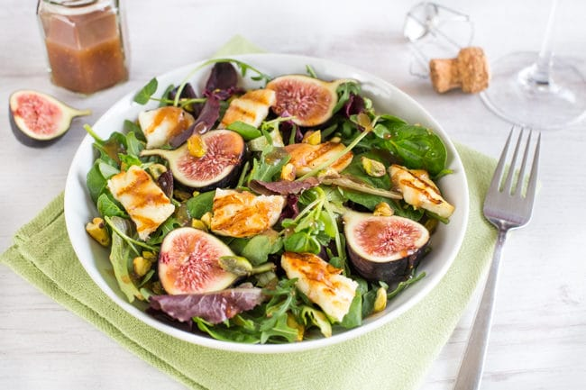 A beautiful fig and halloumi salad in a bowl.