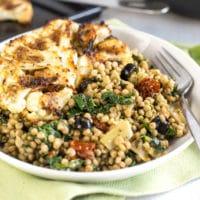 Mediterranean couscous with roasted cauliflower steaks