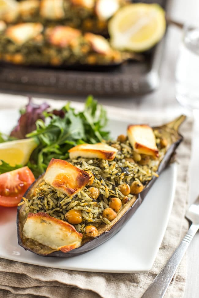 Stuffed aubergines with spinach rice and halloumi - the perfect vegetarian dinner to serve alongside a simple salad! The crispy halloumi on top really takes it to the next level.