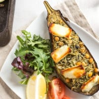 Stuffed aubergines with spinach rice and halloumi