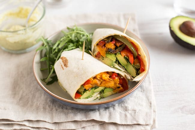 Avocado and sweet potato wraps with basil pesto mayonnaise and rocket - such a simple combination, but so tasty! Perfect for a vegetarian / vegan lunch.