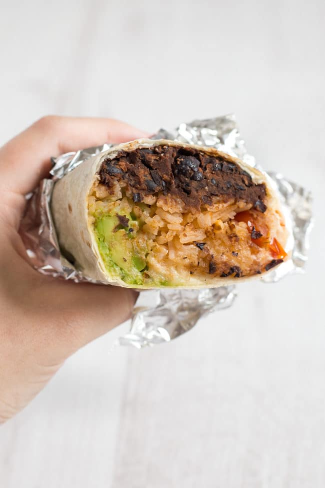 BBQ bean burritos - super tasty vegetarian burritos stuffed with BBQ black beans, spicy tomato rice, mashed avocado and cheese! So easy, and so full of flavour.
