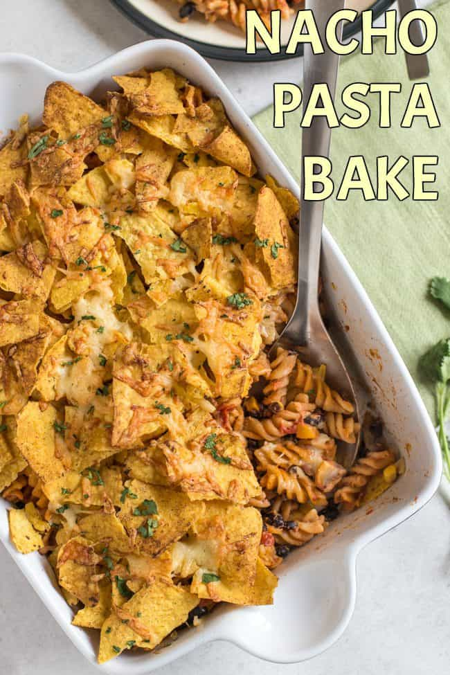 Nacho pasta bake - a creamy, spicy, vegetarian Mexican inspired pasta bake topped with tortilla chips and plenty of cheese!