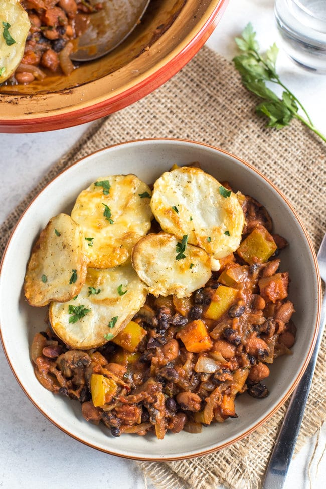 Spicy bean hotpot with crispy potato topping - the perfect healthy vegetarian comfort food! A spicy bean stew with lots of veggies and crispy, cheesy potatoes!