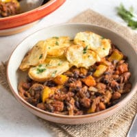Spicy bean hotpot with crispy potato topping