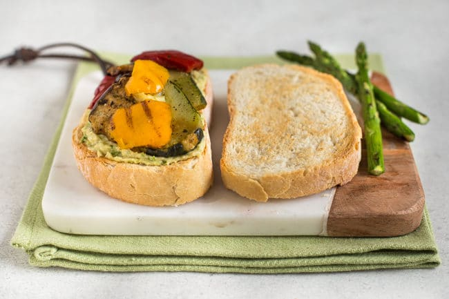 Vegetarian pate in an open sandwich with griddled vegetables