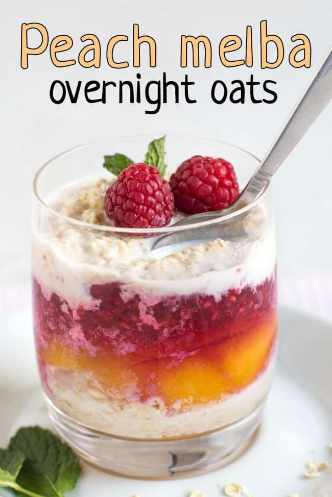 Layered overnight oats with peaches and raspberry sauce, topped with fresh raspberries