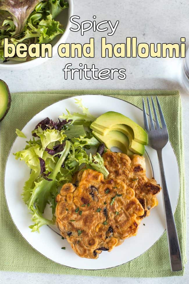 Vegetarian bean and halloumi fritters on a plate with salad and avocado