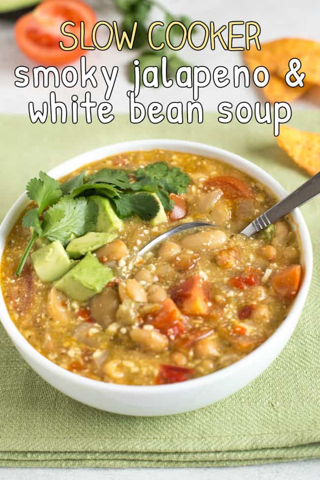 Jalapeno and white bean soup in a bowl with avocado and cilantro