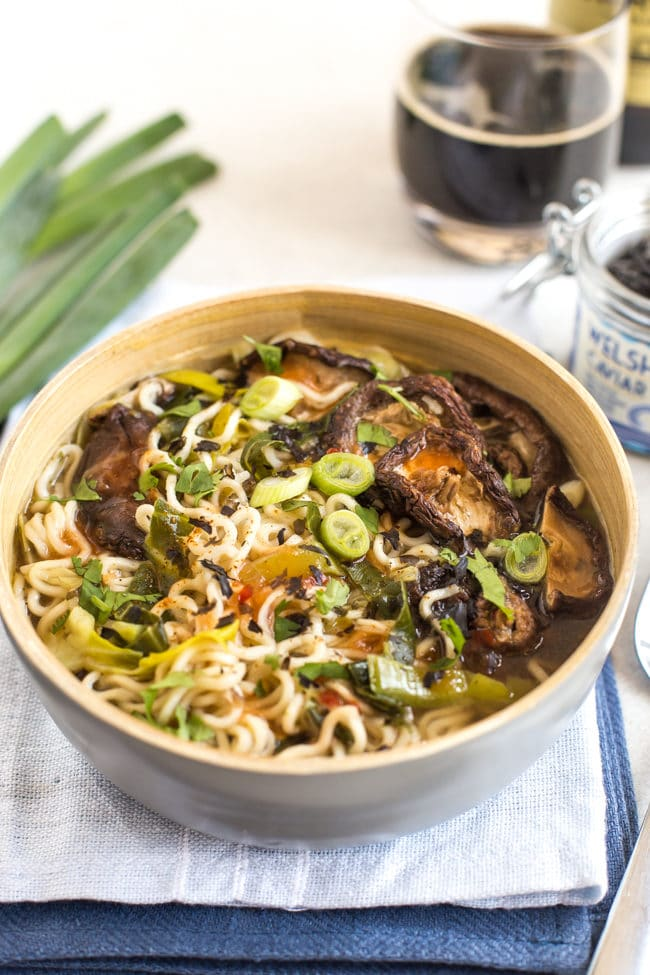 Shiitake mushroom noodle soup in a bowl on a blue linen