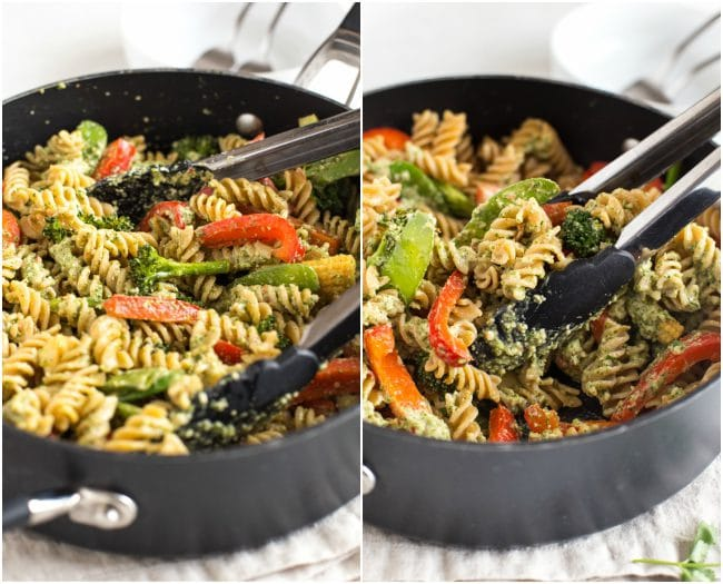 Thai pesto pasta in a pan, being tossed with a pair of tongs