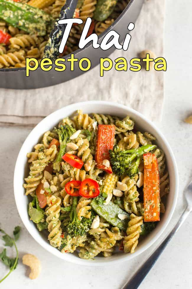 Thai pesto pasta with veggies, in a white bowl shot from above