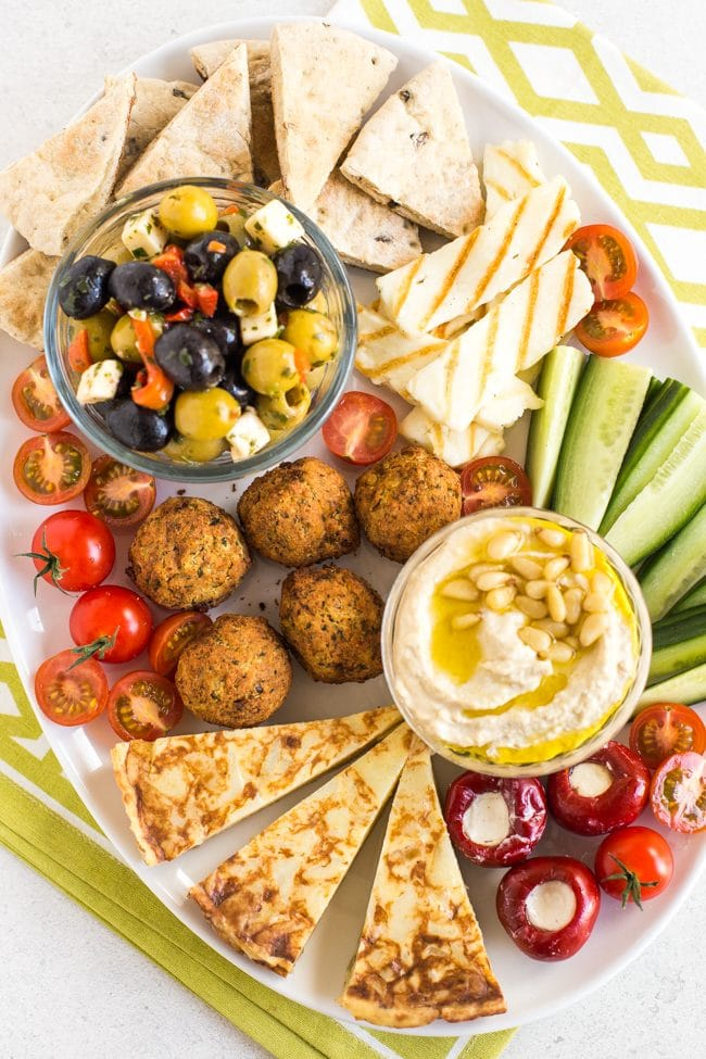 Vegetarian mezze platter with falafel, hummus, olives, pitta bread and more