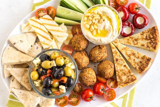 Vegetarian mezze platter with hummus, falafel, olives, and more