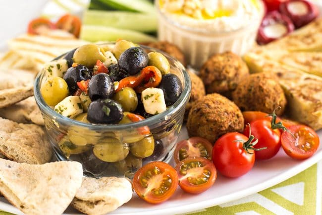 Close up of olives and tomatoes on a vegetarian mezze platter