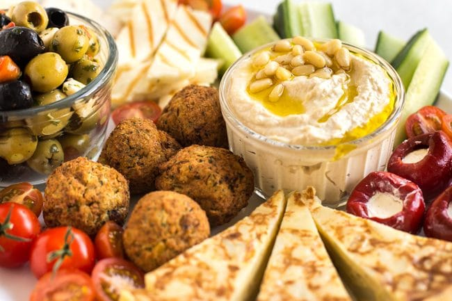 Close up of hummus and falafel on a vegetarian mezze platter