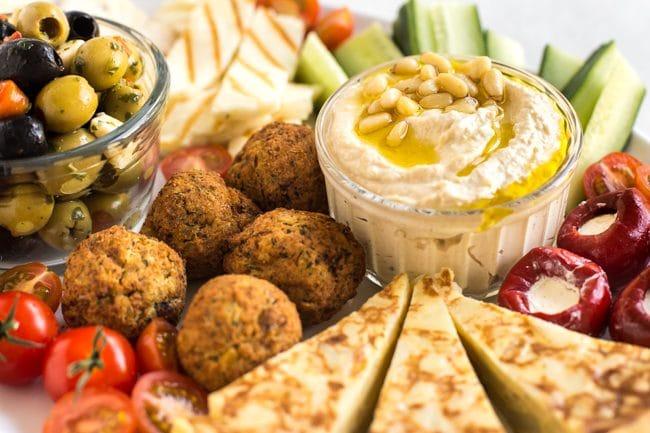 Close up of hummus and falafel on a vegetarian mezze platter
