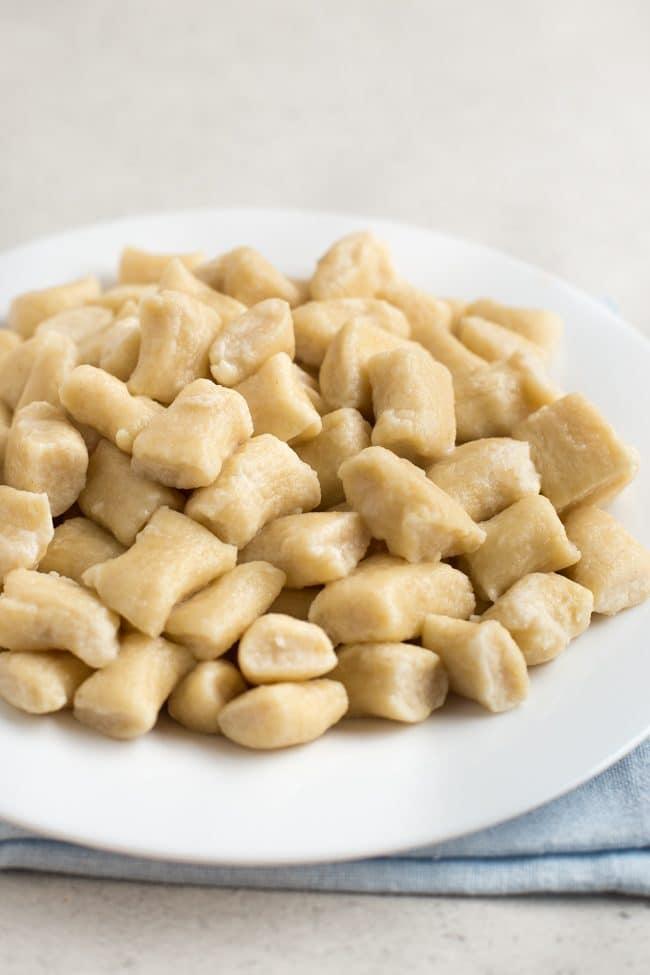 Boiled ricotta gnocchi on a white plate