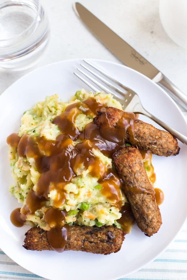 Vegetarian bangers and mash with gravy shot from above