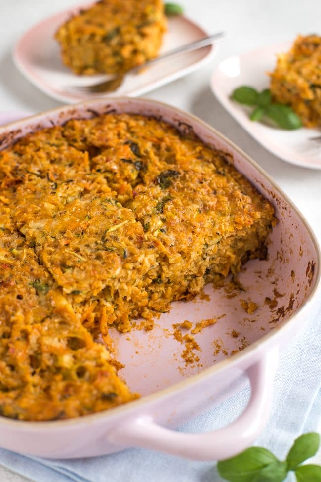 Very veggie oat bars in a baking dish with two pieces removed