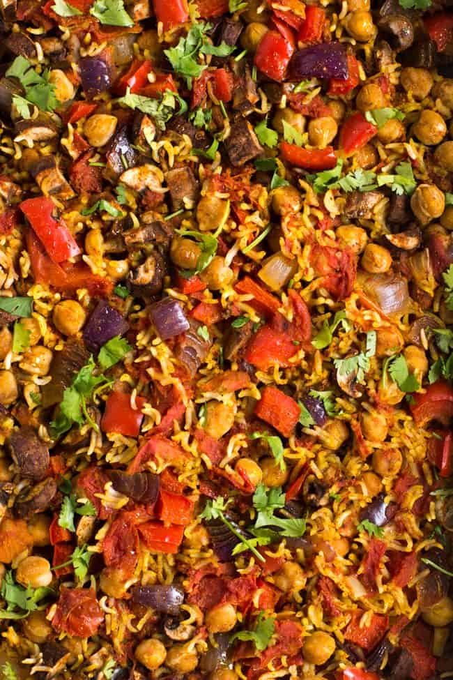 Extreme close-up of chickpea curry and rice bake with vegetables